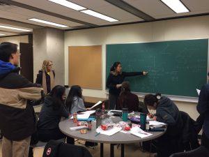 Math Circle students sharing solutions.